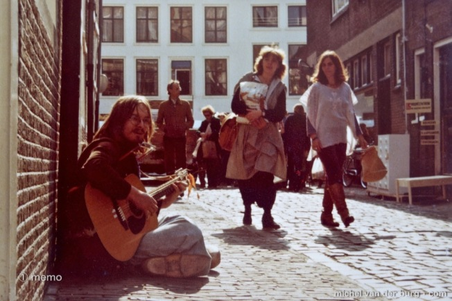 ① memo 20160103 ~ Street Musician 70s ~ Street musician (note : with wooden shoes) in the 1970s in the city center of Leiden , Holland.